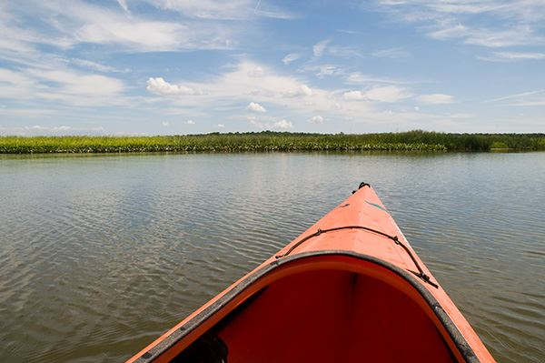 Bow (front) shot perspective from seat of a kayak looking out on the horizon on the Patuxent River