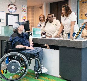disable patron visiting a local community center