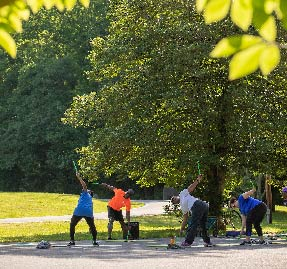 a group of people stretching in a park