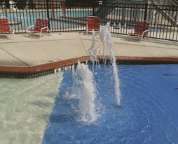The pool fountains at the Ellen E. Linson Splash Park on a sunny day
