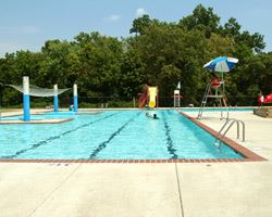 View of the Lane Manor Splash Park pool with water slide on a sunny day