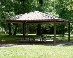 Photo of an open picnic shelter inside of a neighborhood