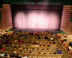 People sitting in seats in an auditorium