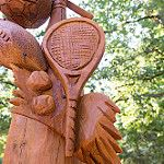 Wooden Sculpture featuring a Tennis Racket