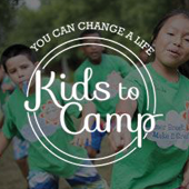 "Kids wearing green shirts. Overlay text reading ""You can change a life - Kids to Camp""."