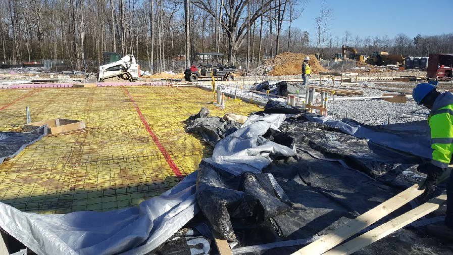 Installation of in-slab utilities and preparation for concrete pour.