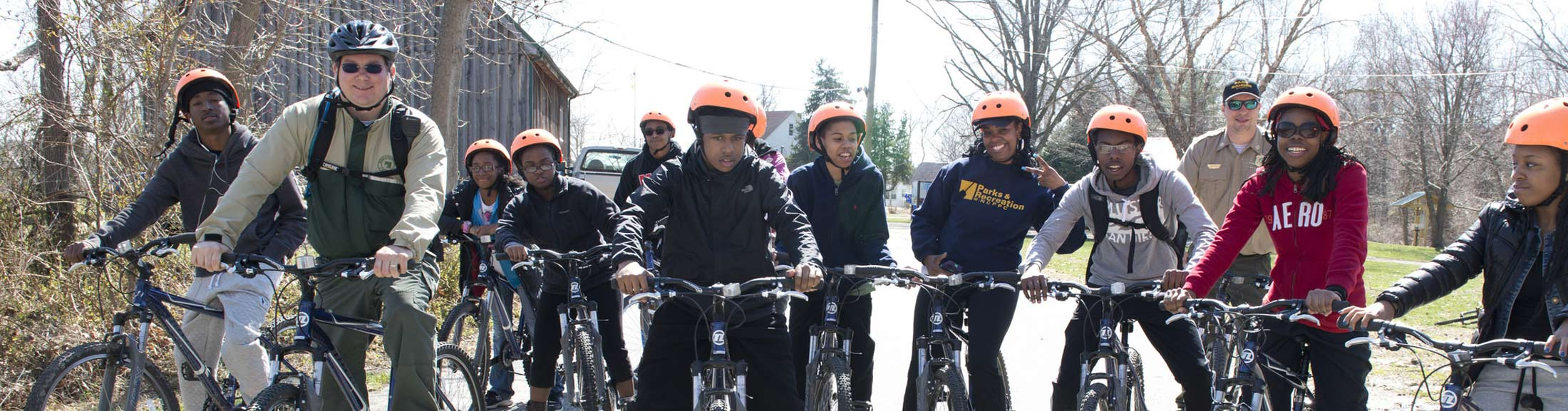 group of teens on a bike ride with a park ranger
