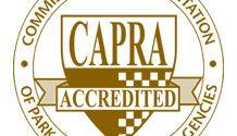 Gold and white logo reading Commission for Accreditation of Park and Recreation Agencies Accredited