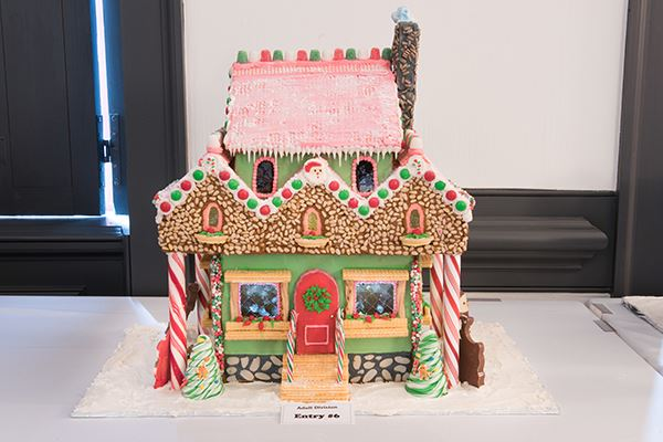 A gingerbread house with candy and icing covering the exterior