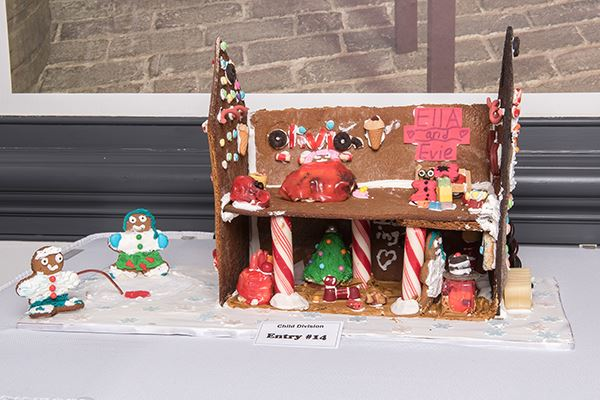 Interior view of a gingerbread house decorated with candy canes and icing
