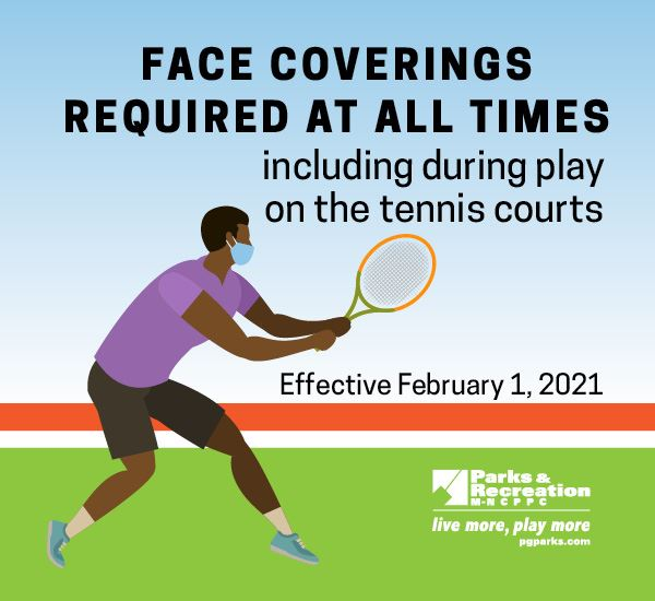 a tennis player wearing a face mask