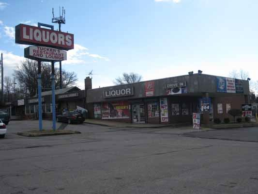 Liquor Store with parking lot and roadway