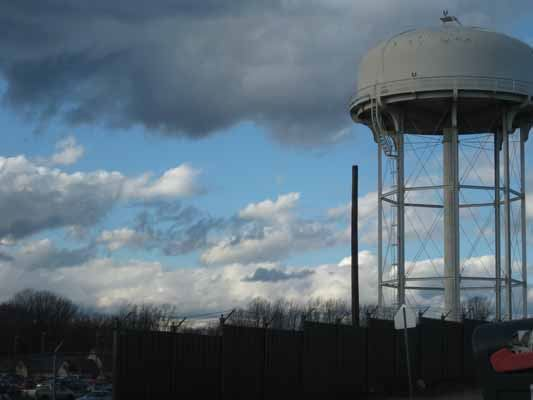 Water Tower with blue skies behind it