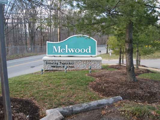 Melwood sing surrounded by landscaping