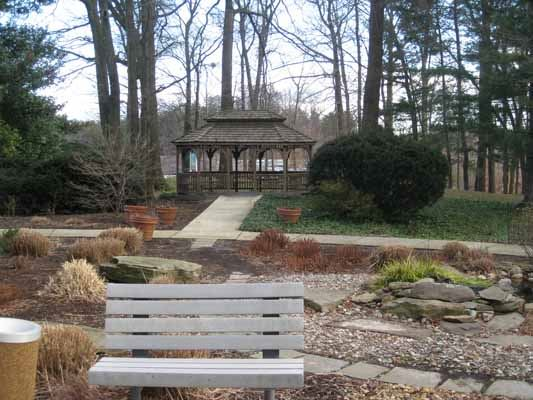 A gazebo in a landscaped park