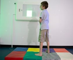 Boy Standing on Sensory Room Mat